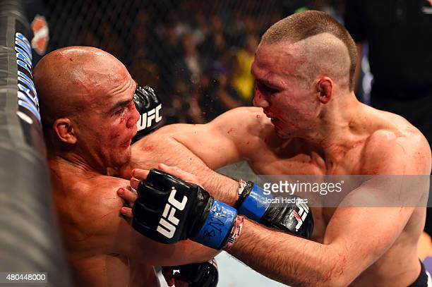 Rory MacDonald elbows Robbie Lawler in their UFC welterweight title fight during the UFC 189 event inside MGM Grand Garden Arena on July 11 2015 in...