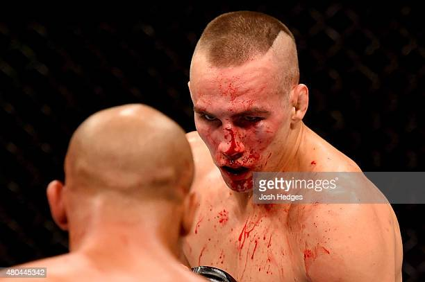 Rory MacDonald faces off against Robbie Lawler in their UFC welterweight title fight during the UFC 189 event inside MGM Grand Garden Arena on July...