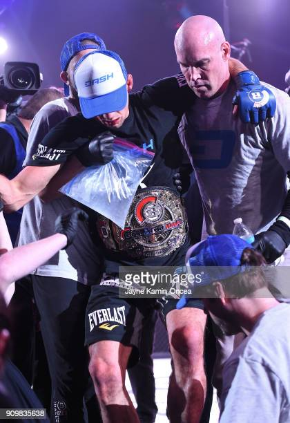 Rory MacDonald he carried out of the cage by his team after defeating Douglas Lima in their Welterweight World Title fight at Bellator 192 at The...