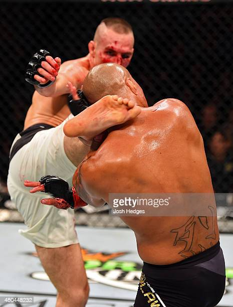 Rory MacDonald kicsk Robbie Lawler in their UFC welterweight title fight during the UFC 189 event inside MGM Grand Garden Arena on July 11 2015 in...