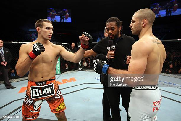 Rory MacDonald of Canada and Tarec Saffiedine of Belgium face off before their welterweight bout at the Scotiabank Centre on October 4 2014 in...
