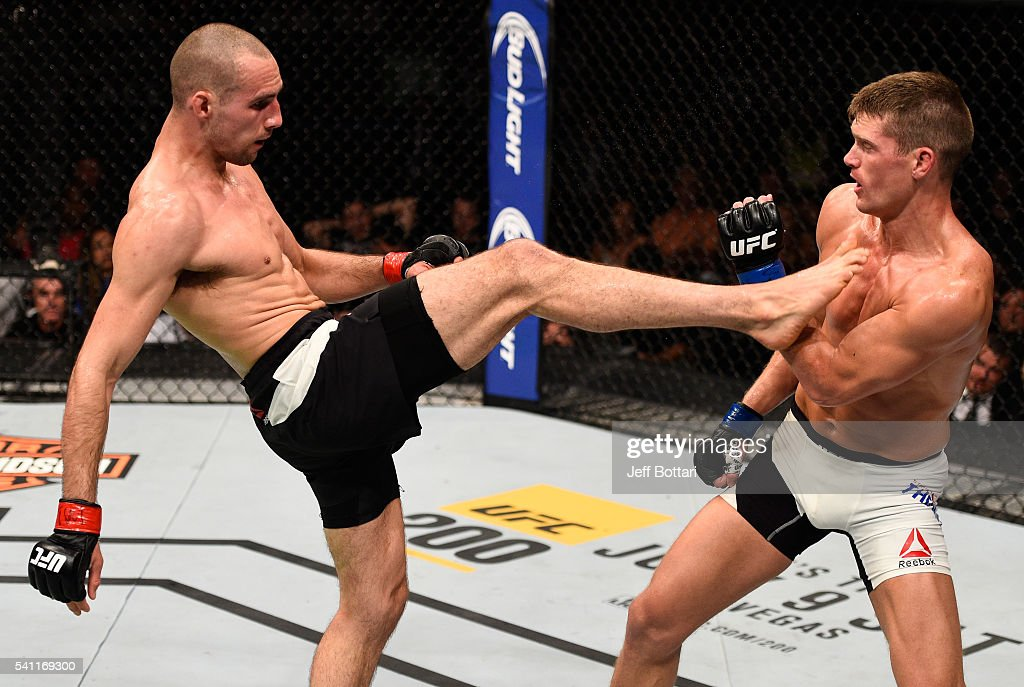 Rory MacDonald of Canada kicks Stephen Thompson of the United States in their welterweight bout during the UFC Fight Night event inside the TD Place Arena on June 18, 2016 in Ottawa, Ontario, Canada.