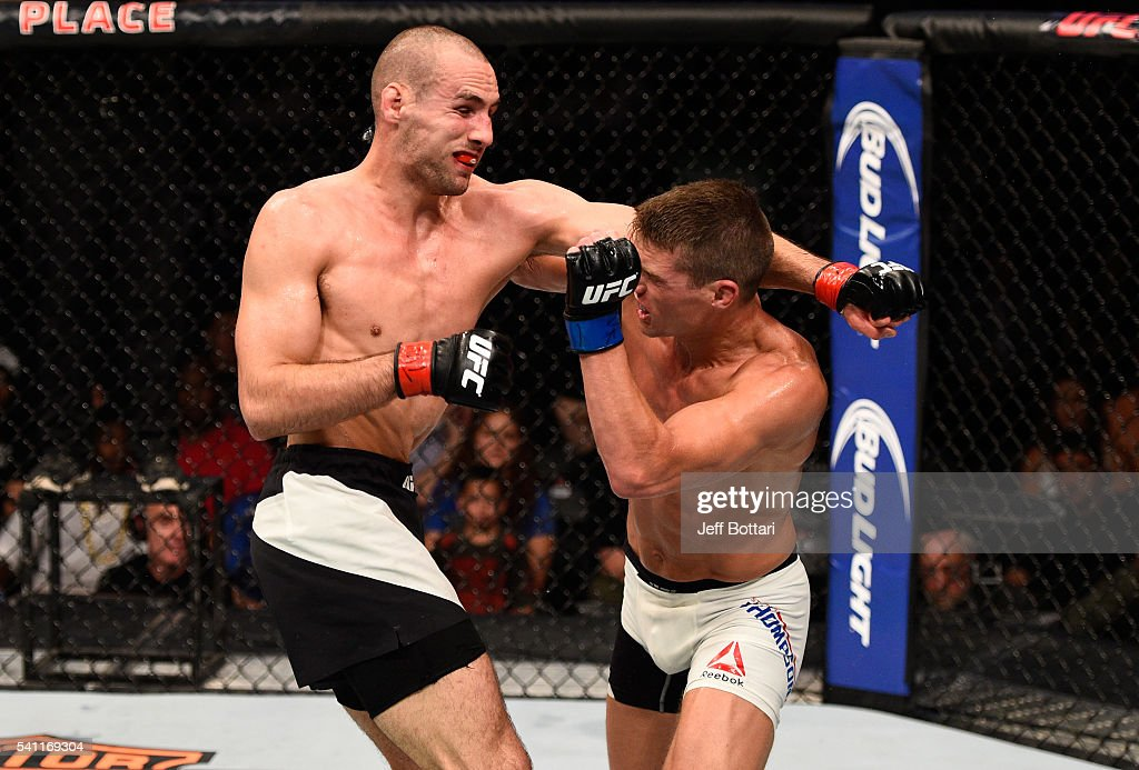Rory MacDonald of Canada punches Stephen Thompson of the United States in their welterweight bout during the UFC Fight Night event inside the TD Place Arena on June 18, 2016 in Ottawa, Ontario, Canada.