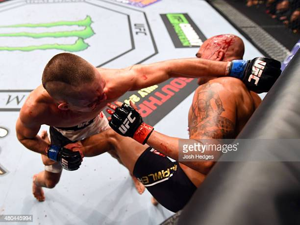 Rory MacDonald punches Robbie Lawler in their UFC welterweight title fight during the UFC 189 event inside MGM Grand Garden Arena on July 11 2015 in...