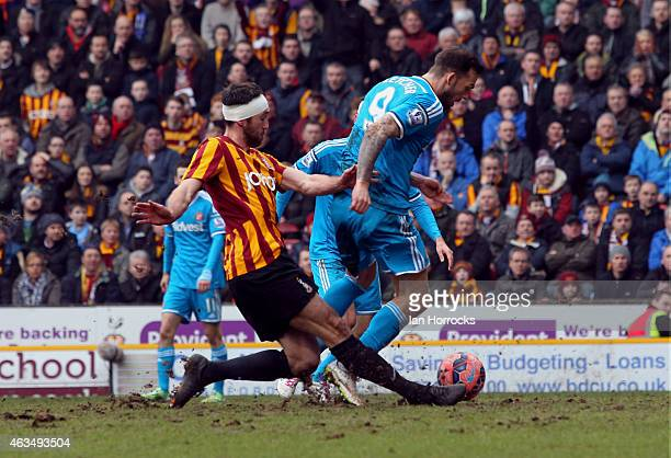 Rory McArdle of Bradford City challenges Steven Fletcher of Sunderland leading to appeals for a penalty from the Sunderland player during the FA Cup...