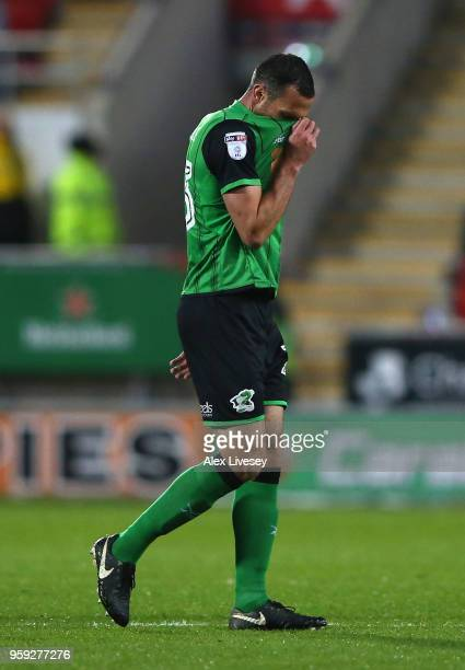 Rory McArdle of Scunthorpe United reacts after being sent off during the Sky Bet League One Play Off Semi Final second leg match between Rotherham...