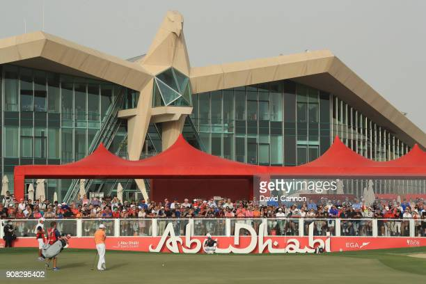 Rory McIlory and Matthew Fitzpatrick on the 18th green during the final round of the Abu Dhabi HSBC Golf Championship at Abu Dhabi Golf Club on...