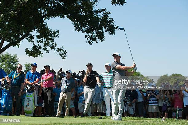 Rory McIlory of Northern Ireland hits his tee shot on the 18th hole during a practice round for the 98th PGA Championship held at the Baltusrol Golf...