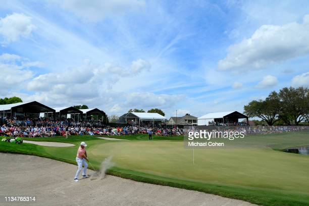 Rory McIlory of Northern Ireland plays his fourth shot from a bunker on the eighth hole during the third round of the Arnold Palmer Invitational...