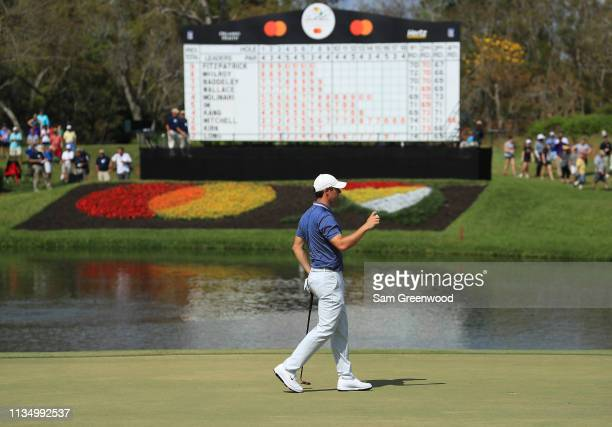Rory McIlory of Northern Ireland waves on the eighth hole during the final round of the Arnold Palmer Invitational Presented by Mastercard at the Bay...