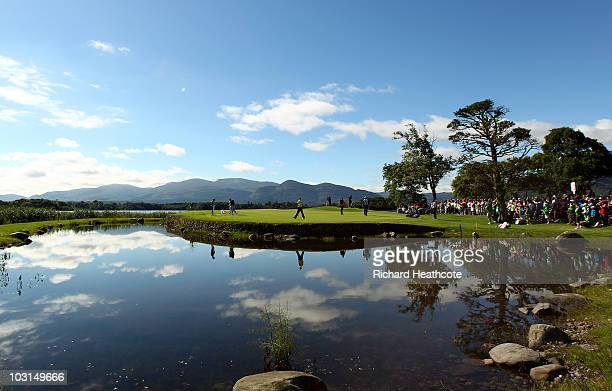 Rory McIlroy and Darren Clarke of Northern Ireland and Rhys Davies of Wales walk onto the 10th green during the first round of the 3 Irish Open at...