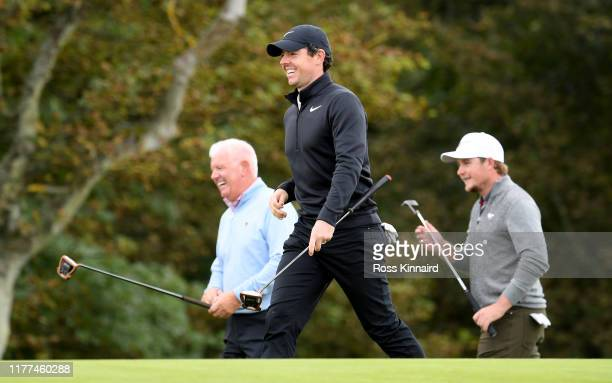 Rory McIlroy and Gerry McIlroy on the 11th green during the second round of the Alfred Dunhill Links Championship at Kingsbarns Links on September 27...