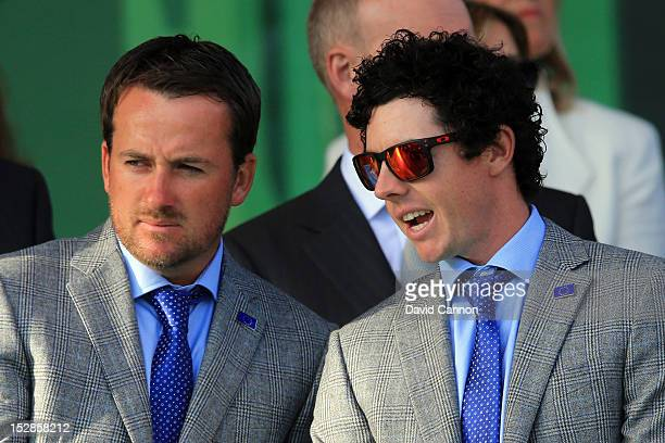 Rory McIlroy and Graeme McDowell of Europe wait on stage during the Opening Ceremony for the 39th Ryder Cup at Medinah Country Club on September 27...