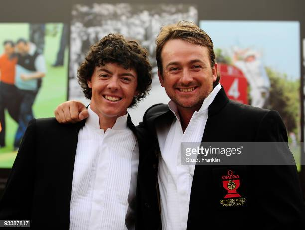 Rory McIlroy and Graeme McDowell of Northern Ireland during the opening ceremony at the Omega Mission Hills World Cup on the Olazabal course on...