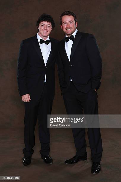 Rory McIlroy and Graeme McDowell of the European Ryder Cup team pose prior to the 2010 Ryder Cup Dinner at the Celtic Manor Resort on September 29,...