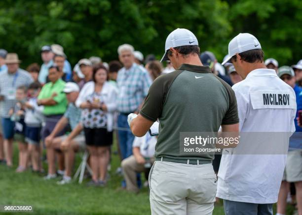Rory McIlroy and his caddie Harry Diamond look over their notes before teeing off during the third round of the Memorial Tournament at Muirfield...