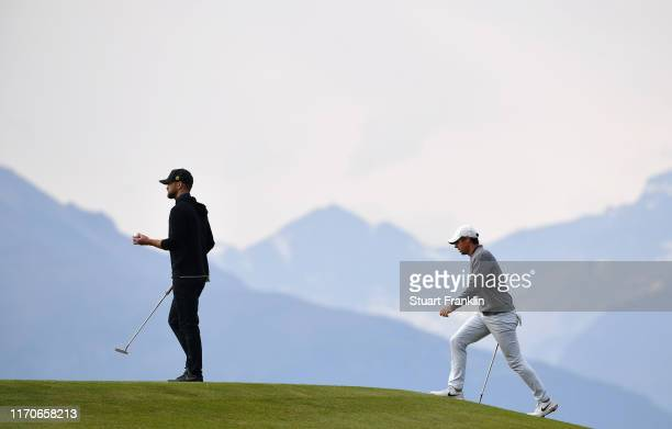 Rory McIlroy and Justin Timberlake walk onto the green during the Pro Am prior to the start of the Omega European Masters at CranssurSierre Golf Club...