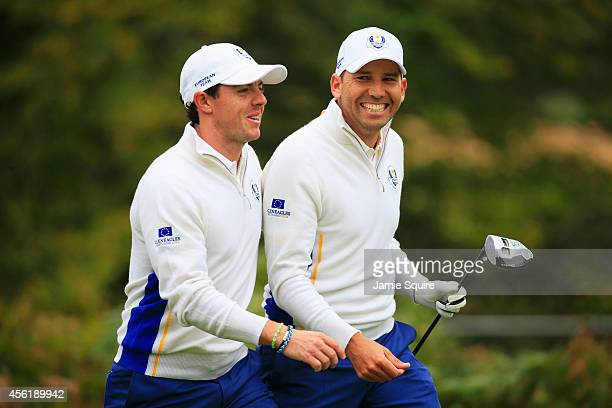Rory McIlroy and Sergio Garcia of Europe walk off the 5th tee during the Afternoon Foursomes of the 2014 Ryder Cup on the PGA Centenary course at the...