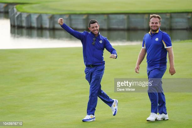 Rory McIlroy and Tyrrell Hatton of Europe celebrate after their side wins during Day Three of the 2018 Ryder Cup at Le Golf National on September 30...