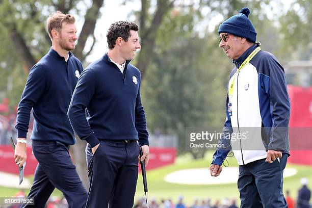 Rory McIlroy and vicecaptain Sam Torrance speak during practice prior to the 2016 Ryder Cup at Hazeltine National Golf Club on September 27 2016 in...