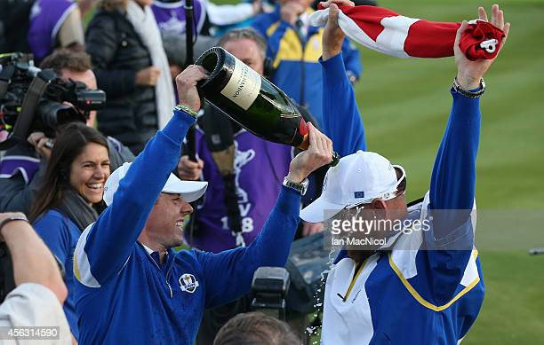 Rory McIlroy celebrates with Thomas Bjorn as Europe retain the Ryder Cup during the Singles Matches of the 2014 Ryder Cup on the PGA Centenary course...