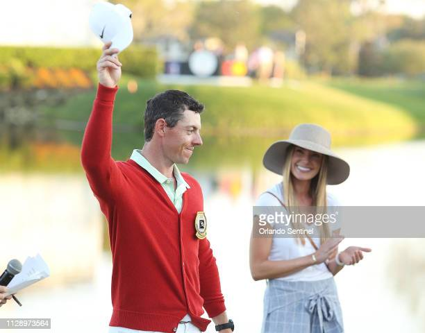 Rory McIlroy celebrates with wife Erica Stoll after winning the Arnold Palmer Invitational on March 18 2018 at Bay Hill Club Lodge in Orlando Fla