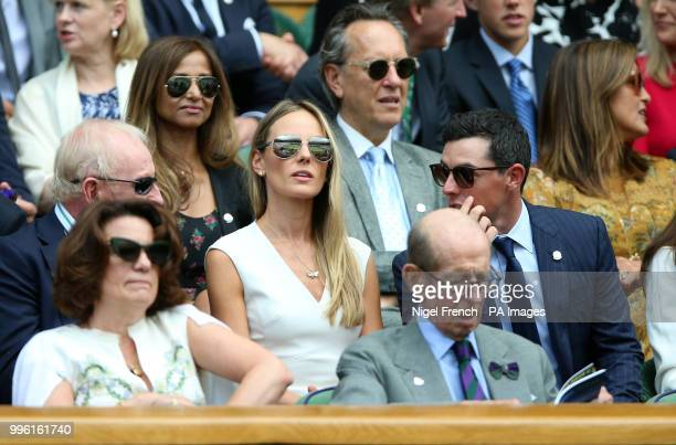 Rory McIlroy Erica Stoll and Rod Laver in the royal box on centre court on day nine of the Wimbledon Championships at the All England Lawn Tennis and...