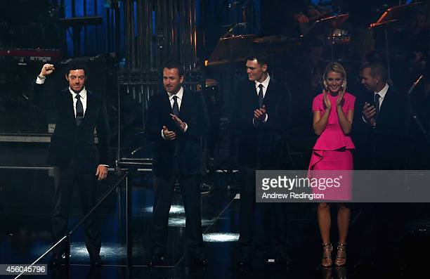 Rory McIlroy Graeme McDowell Martin Kaymer and Sergio Garcia of Europe with Katharina Boehm pose on stage during the 2014 Ryder Cup Gala Concert at...