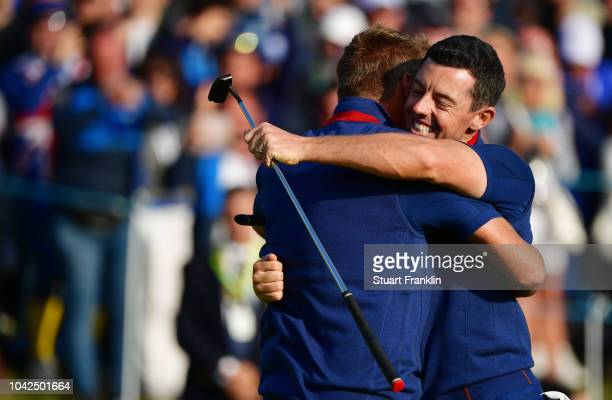Rory McIlroy of Europe and Ian Poulter of Europe celebrate during the afternoon foursome matches of the 2018 Ryder Cup at Le Golf National on...
