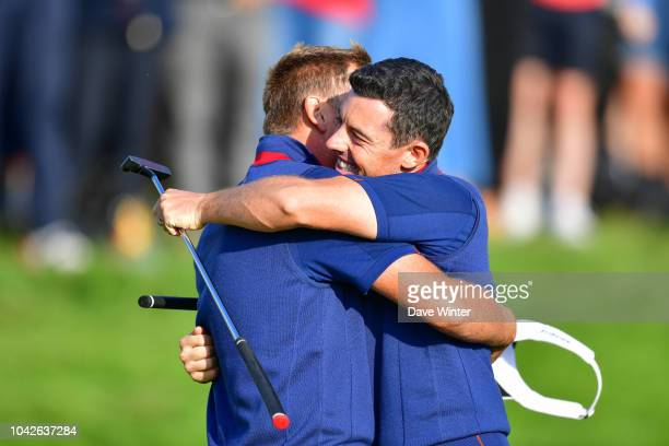 Rory McIlroy of Europe and Ian Poulter of Europe celebrate their victory in the Foursomes during Day One of the 2018 Ryder Cup at Le Golf National on...