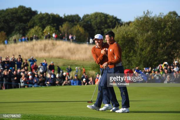 Rory McIlroy of Europe and Sergio Garcia of Europe celebrate during the morning fourball matches of the 2018 Ryder Cup at Le Golf National on...