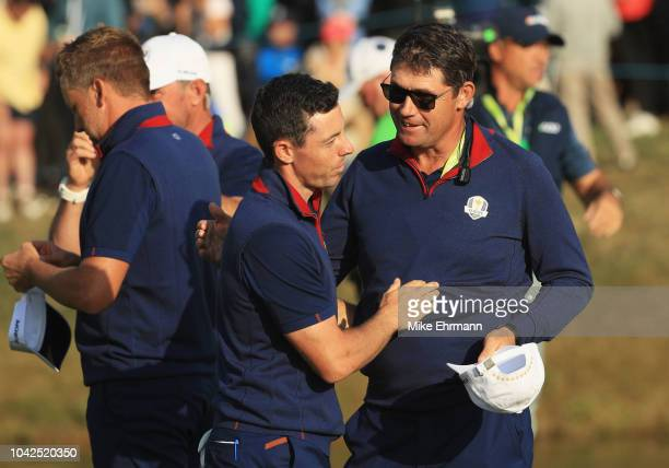 Rory McIlroy of Europe and ViceCaptain Padraig Harrington of Europe celebrate during the afternoon foursome matches of the 2018 Ryder Cup at Le Golf...