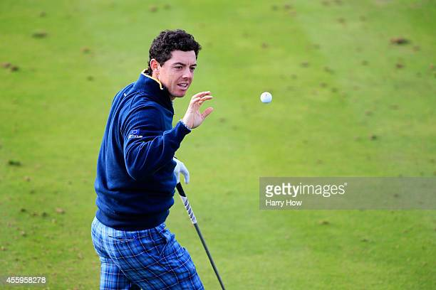 Rory McIlroy of Europe catches a golf ball during practice ahead of the 2014 Ryder Cup on the PGA Centenary course at the Gleneagles Hotel on...