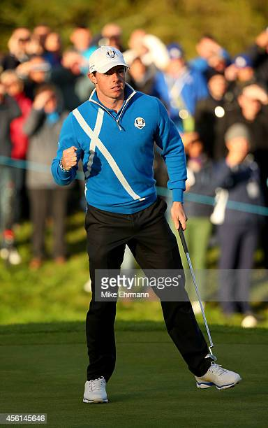 Rory McIlroy of Europe celebrates a putt on the 17th green during the Afternoon Foursomes of the 2014 Ryder Cup on the PGA Centenary course at the...