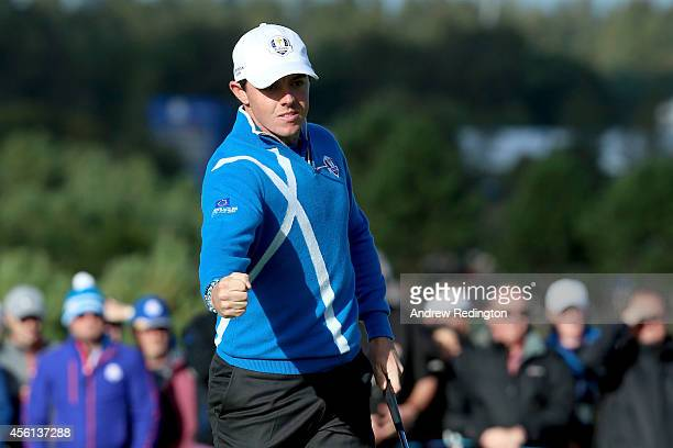 Rory McIlroy of Europe celebrates a putt on the 8th green during the Afternoon Foursomes of the 2014 Ryder Cup on the PGA Centenary course at the...
