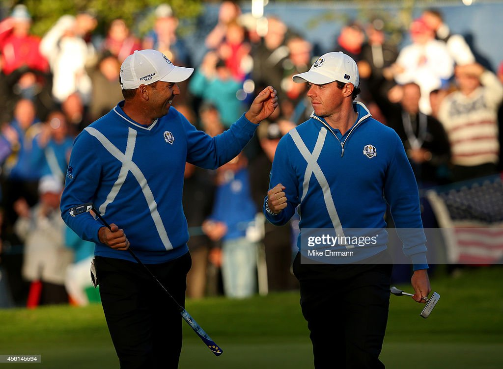 Rory McIlroy (R) of Europe celebrates a putt with Sergio Garcia of Europe on the 17th green during the Afternoon Foursomes of the 2014 Ryder Cup on the PGA Centenary course at the Gleneagles Hotel on September 26, 2014 in Auchterarder, Scotland.