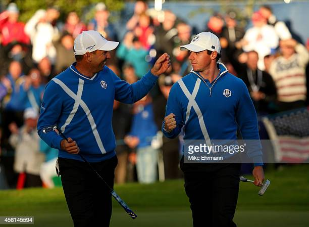 Rory McIlroy of Europe celebrates a putt with Sergio Garcia of Europe on the 17th green during the Afternoon Foursomes of the 2014 Ryder Cup on the...