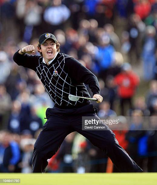 Rory McIlroy of Europe celebrates holing a birdie putt on the 17th green during the rescheduled Morning Fourball Matches during the 2010 Ryder Cup at...
