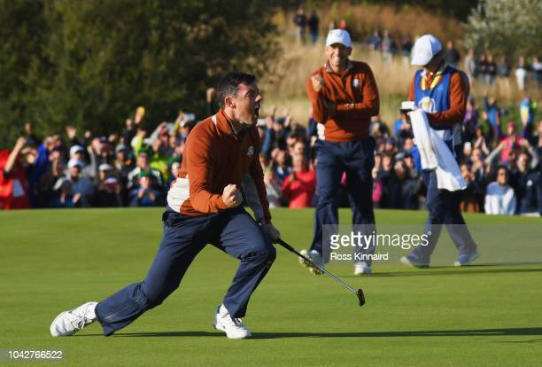 Rory McIlroy of Europe celebrates on the fifth green during the morning fourball matches of the 2018 Ryder Cup at Le Golf National on September 29...