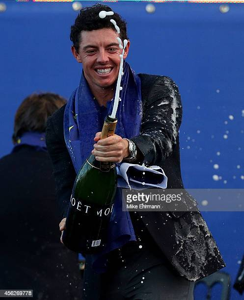 Rory McIlroy of Europe celebrates winning the Ryder Cup by spraying champagne after the Singles Matches of the 2014 Ryder Cup on the PGA Centenary...