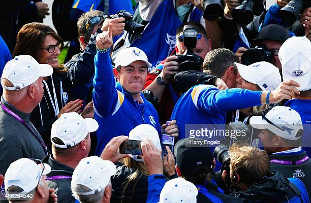Rory McIlroy of Europe celebrates winning the Ryder Cup during the Singles Matches of the 2014 Ryder Cup on the PGA Centenary course at the...
