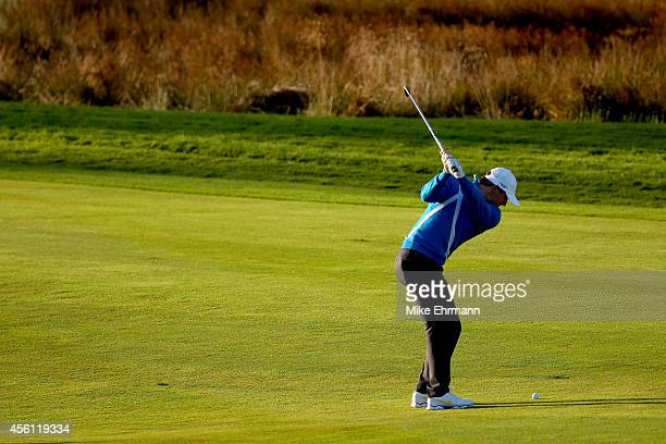 Rory McIlroy of Europe hits his approach on the 1st hole during the Morning Fourballs of the 2014 Ryder Cup on the PGA Centenary course at the...