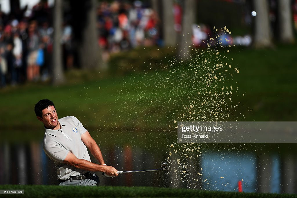 Rory McIlroy of Europe hits out of a bunker on the 12th hole during morning foursome matches of the 2016 Ryder Cup at Hazeltine National Golf Club on October 1, 2016 in Chaska, Minnesota.