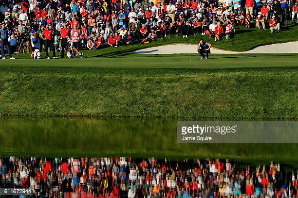 Rory McIlroy of Europe lines up a putt on the 16th green during afternoon fourball matches of the 2016 Ryder Cup at Hazeltine National Golf Club on...