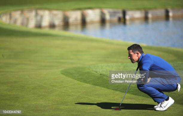 Rory McIlroy of Europe lines up a putt on the second green during singles matches of the 2018 Ryder Cup at Le Golf National on September 30 2018 in...