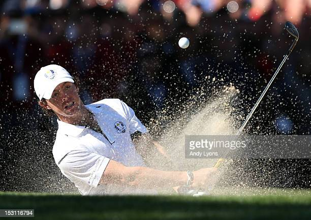 Rory McIlroy of Europe plays a bunker shot on the 14th hole during the Singles Matches for The 39th Ryder Cup at Medinah Country Club on September...