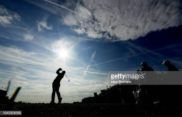 Rory McIlroy of Europe plays a shot during the morning fourball matches of the 2018 Ryder Cup at Le Golf National on September 28, 2018 in Paris,...