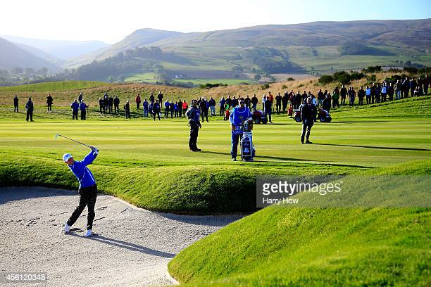 Rory McIlroy of Europe plays from a bunker on the 3rd hole during the Morning Fourballs of the 2014 Ryder Cup on the PGA Centenary course at the...