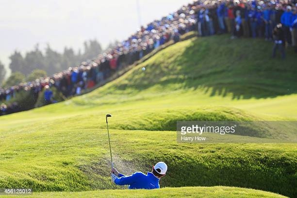 Rory McIlroy of Europe plays from a bunker on the 7th hole during the Morning Fourballs of the 2014 Ryder Cup on the PGA Centenary course at the...