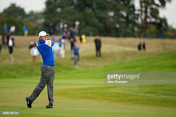 Rory McIlroy of Europe plays his approach on the 2nd hole during the Singles Matches of the 2014 Ryder Cup on the PGA Centenary course at the...